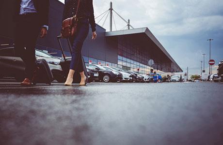 Close up of feet walking to Detroit Metro airport parking lot.