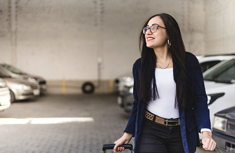 Woman Walking in Detroit Metro Airport Valet Parking Structure