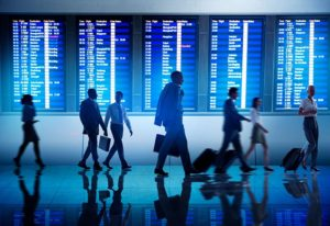 business travelers in an airport terminal
