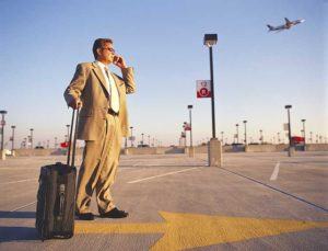 businessman at airport parking lot