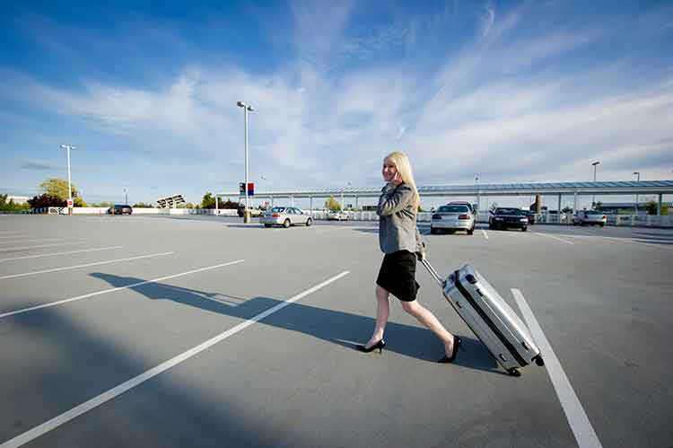 Businesswoman Walking Into Airport - Newark, NJ - Jiffy Airport Parking